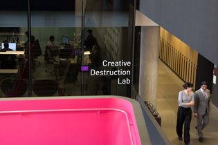 Photo of the Creative Destruction Lab and a pair of students walking by